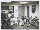 Woman reading aloud to children (2)